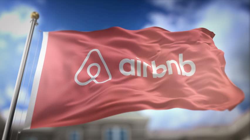 BRISBANE, AUSTRALIA - APRIL 23, 2017 : Airbnb Flag Waving Slow Motion 3D Rendering Blue Sky Background - Editorial Animation Seamless Loop 4K
