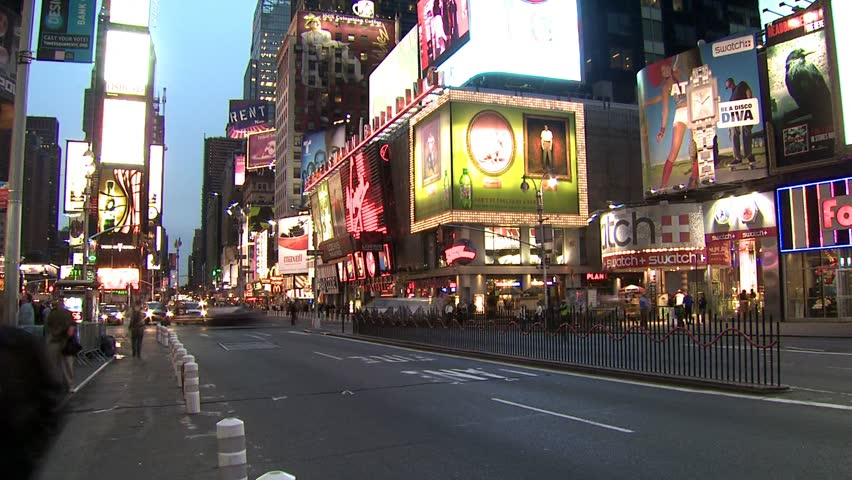NEW YORK, NEW YORK, USA  - CIRCA MAY 2006: Taxicabs, pedestrians and city buildings at dusk | Shutterstock HD Video #2615075