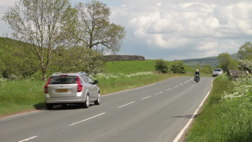WHARFEDALE, YORKSHIRE/ENGLAND - JUNE 4: Traffic rushes through the peace and quiet of the countryside on June 4, 2012 in Wharfedale. The Yorkshire Dales National Park is famous for its tranquility.