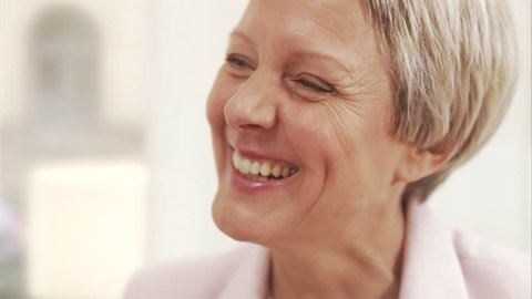 A smiling middle aged woman