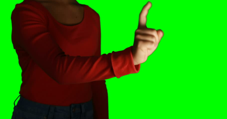 Woman pretending to use an invisible screen against chroma key background | Shutterstock HD Video #26205620