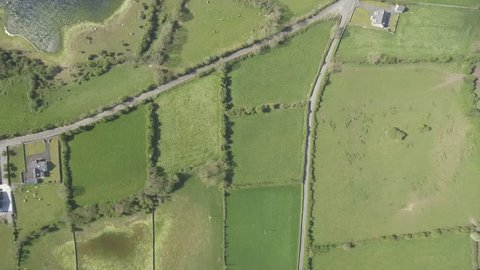 Epic Aerial view of the beautiful Irish countryside nature landscape from the Burren national park in County Clare Ireland. Flat video profile.