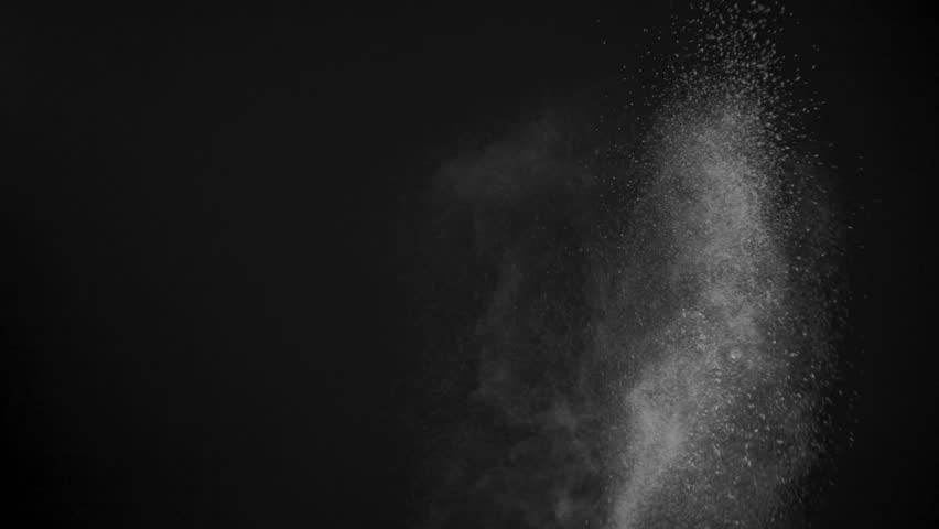 White powder exploding isolated on black