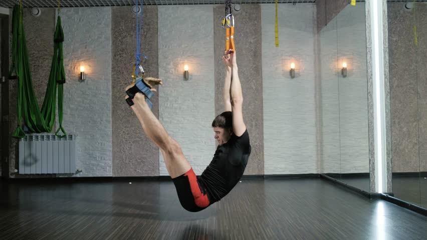 A man performs exercises alfagraviti in the studio