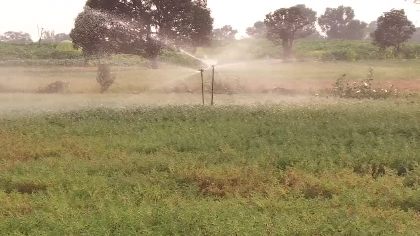 water sprinkler in crop field, Salunkwadi, Ambajogai Beed, Maharashtra, India, southeast, Asia.
