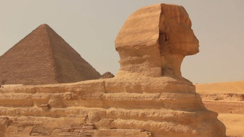 Observe Great Sphinx and pyramids in plateau of Giza