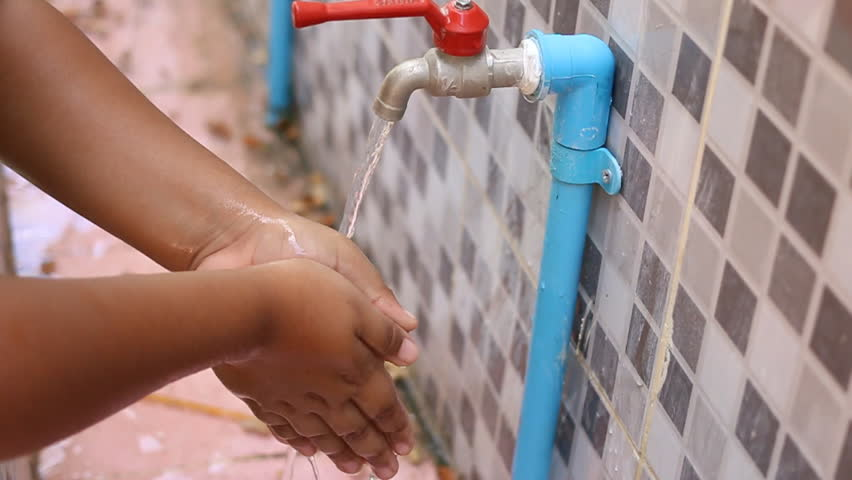Boy cleaning hand with water  | Shutterstock HD Video #26254580