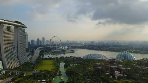 4k erial fly-over view of Gardens By The Bay, Singapore. Featuring Supertree Grove, Cloud Forest and Flower Dome