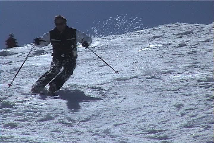 Park City, UT - April 1999: Members of the Professional Ski Instructors of America ski moguls during spring clinic.