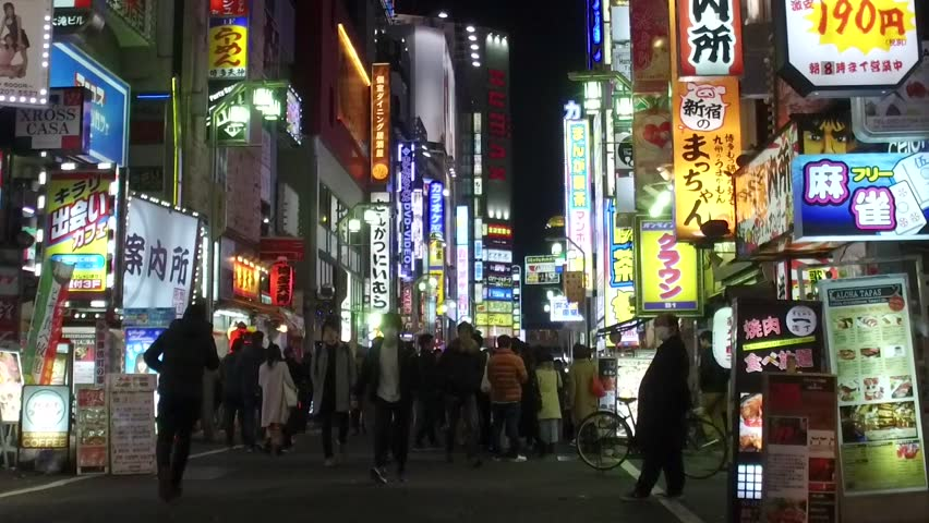 TOKYO, JAPAN - CIRCA MARCH, 2017: POV Walking in Kabuki-cho district of Shinjuku Ward. The area is a renown nightlife and red-light district.