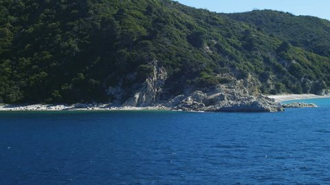 Monastic State of the Holy Mountain. Blue Aegean Sea off the coast of Athos. Rocks. Green Hills. Seagulls Autonomous Monastic State of the Holy Mountain. Mount Athos.