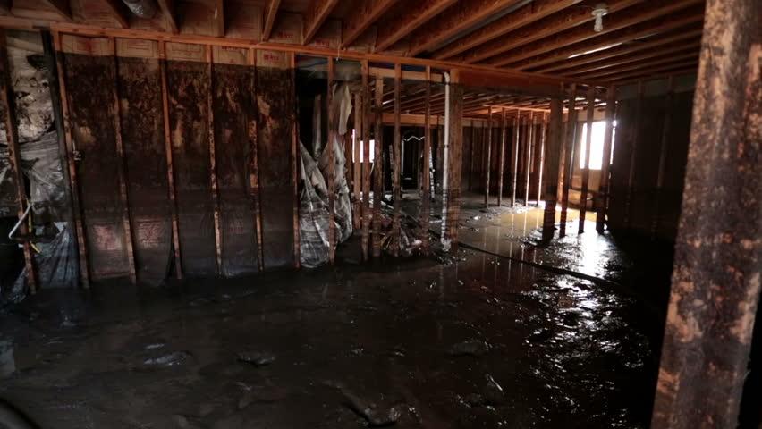 FOUNTAIN GREEN, SANPETE, UTAH 31 JUL 2012: Flood Home Basement. Water Mud