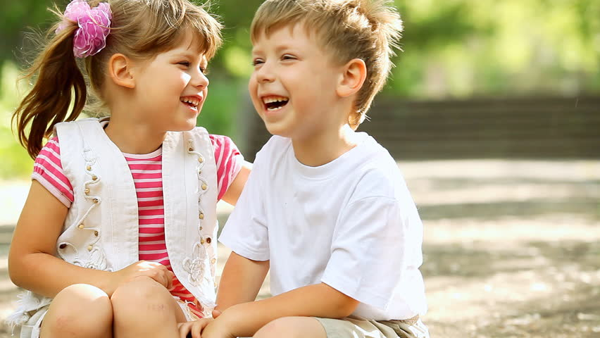 Two child funning in park, outdoors | Shutterstock Video #2632940