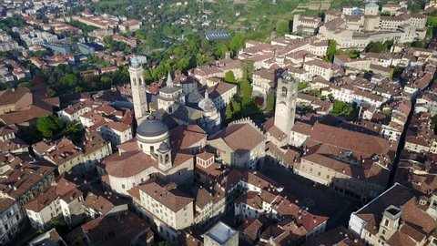 Drone aerial view of Bergamo - Old city (Cittˆ Alta). One of the beautiful city in Italy. Landscape on the city center, the main square and its historical buildings during a wonderful blu day