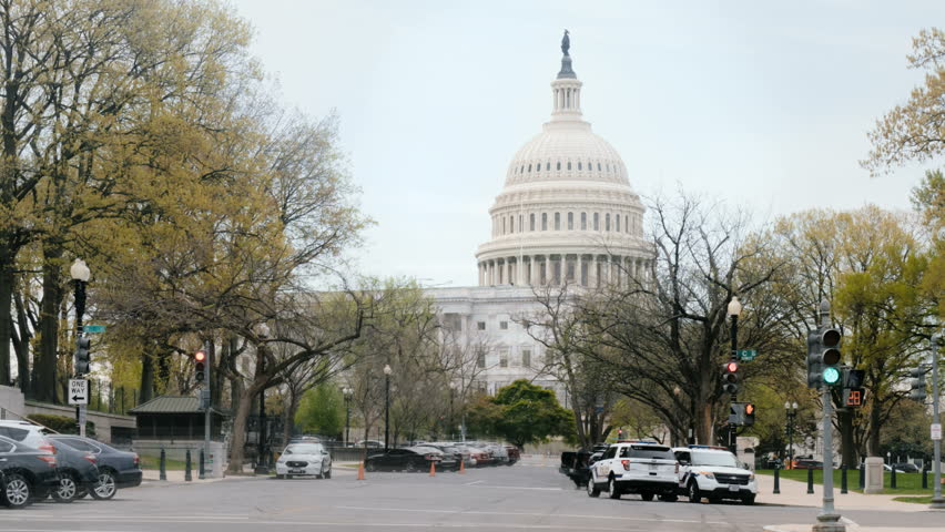 WASHINGTON, DC - APRIL 14: (Timelapse) United States Capitol Building with city traffic blur on April 14, 2017. The US Capital Building is the home of Congress of the U.S. federal government.