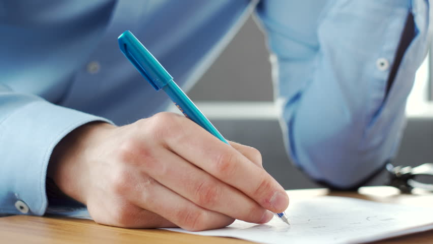 Close up gestures and movements of male director hand with pen over business paper on the desk during emotional working conversation on telephone and making notes in the office during sunny morning | Shutterstock HD Video #26382500