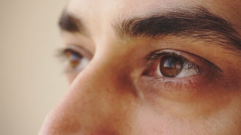 Close up of man's brown eyes looking upward