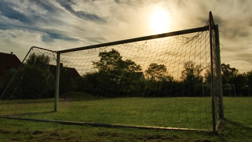 Soccer Goalposts at sunset with slight zoom out. This is still frame animation from uncompressed 35mm digital stills shot on the highest quality Canon L lens.