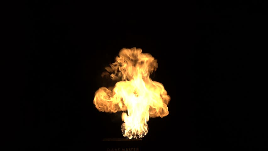 Slow motion burning gas flame blast isolated on black background.