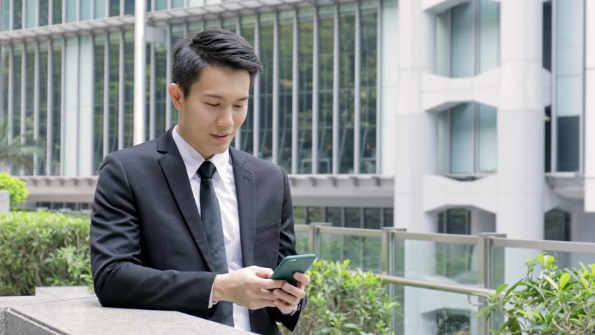 Businessman working on cellphone, mobile office concept