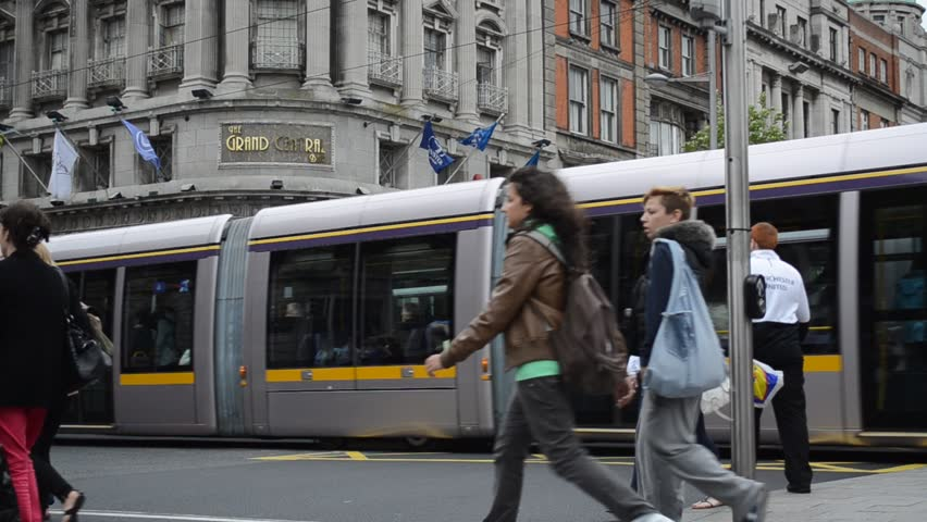 DUBLIN, IRELAND - CIRCA 2011: Public transport tram system (LUAS) and people