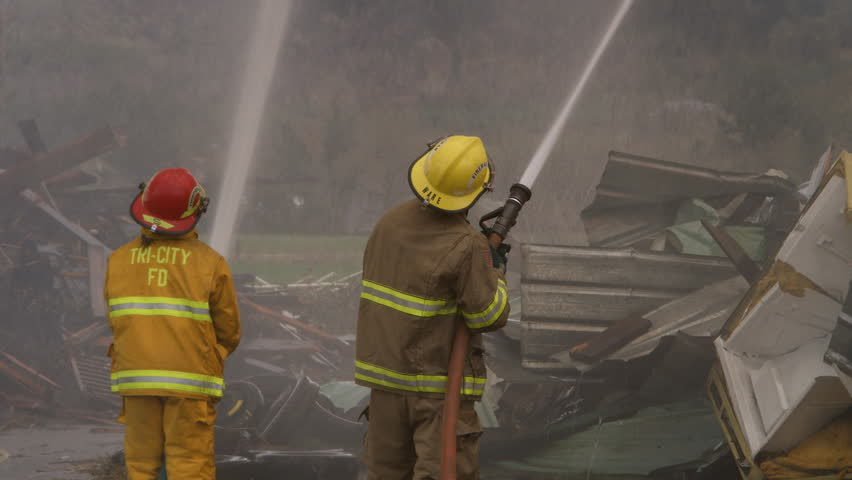 Firefighters using high pressure hoses   Shutterstock HD Video #26508920