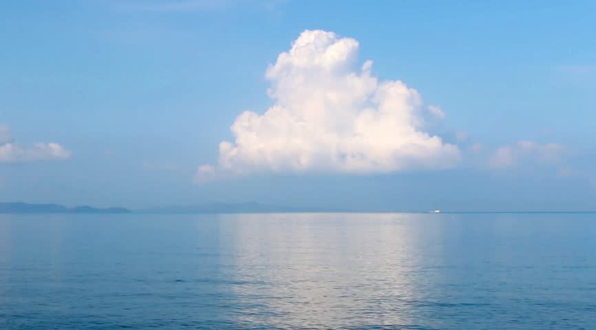 Seascape, sea view in sunny day,blue sky, big clouds, calm sea surface, ripple soft waves, clouds reflection in the water