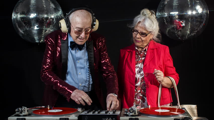 amazing DJ grandma and grandpa, older couple djing and partying in a disco setting. these retired rockers will get the party going