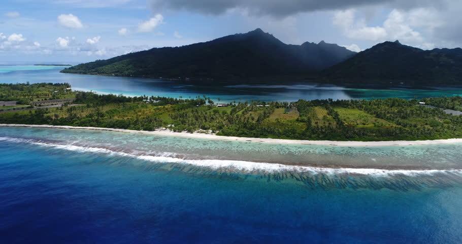 French Polynesia Tahiti aerial view of island Huahine and Motu Murimaora, coral reef lagoon and Pacific Ocean. Tropical paradise.