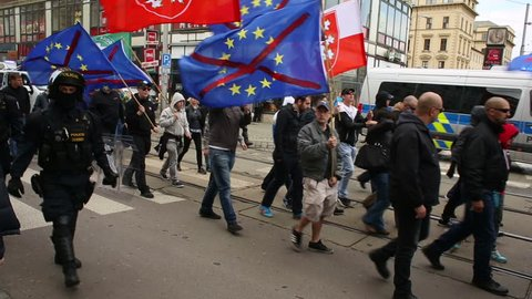 BRNO, CZECH REPUBLIC, MAY 1, 2017: March of radical extremists, suppression of democracy, against the government of the Czech Republic, European Union, against refugees, police, flags, Europe, EU