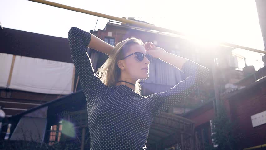Young slim girl looks around walking through the industrial part of the city | Shutterstock HD Video #26550950