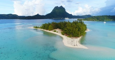 Bora Bora in French Polynesia. Aerial view of Motu paradise island and turquoise blue water in coral reef lagoon and Mt Pahia, Mount Otemanu, Tahiti, South Pacific Ocean.