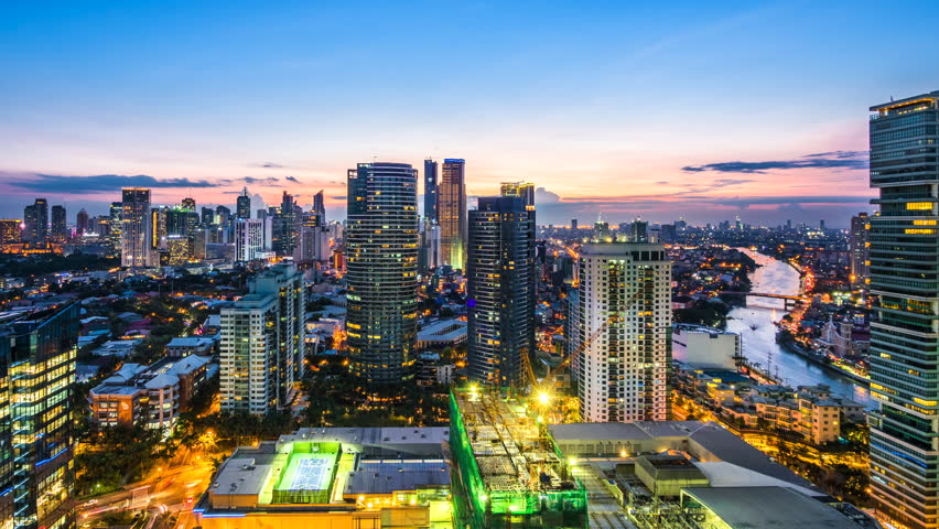 Metro Manila time lapse, looking over Makati city skyline and Pasig river at sunset in Manila, Philippines.