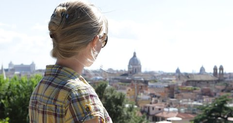 4K Beautiful woman enjoy historic skyline, blonde female relax, Rome cityscape view