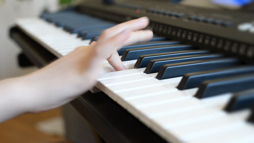 Little girl learning to play the piano. | Shutterstock HD Video #26586620