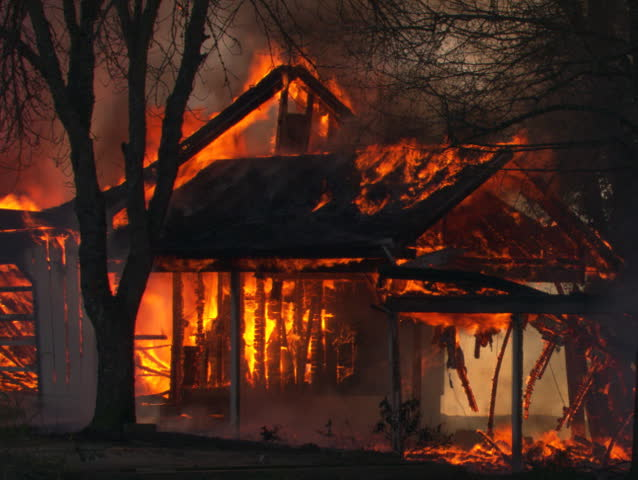 Skeletal remains of burning house near collapse | Shutterstock HD Video #26592500