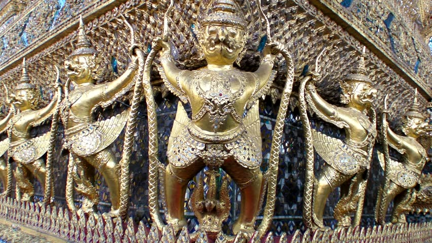 Golden sculpture of Garuda ( bird) and Naga (snake) around the wall - Royal Temple Of The Emerald Buddha Image - Grand Palace - Bangkok, Thailand