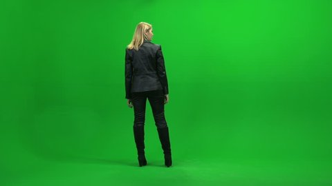 young business women walking arround discovering new place. person isolated against green screen background