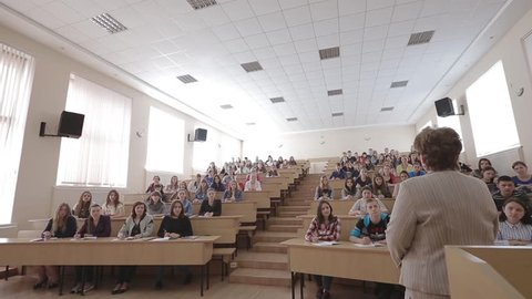 VINNITSA, UKRAINE - MAY 2017: Speaker giving presentation in lecture hall at university. Participants listening to lecture and making notes