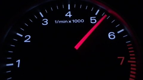 Car speedometer and moving,featuring lights leaks, a speedometer, and long exposure time lapse traffic,Abstract night driving montage,The car pics up speed, Rounds Per Minute Display Informations car,