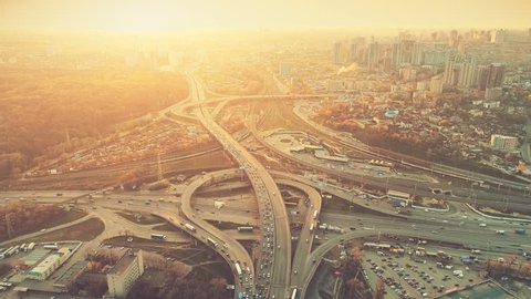 Aerial Drone Flight View of freeway busy city rush hour heavy traffic jam highway. Top view. Cityscape in sunset soft light. Instagram vintage filter toning. Kiev, capital of Ukraine. Slow motion 4k