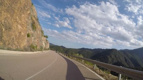 Driving lots of curves with a motorbike on Sardinia (Italy).