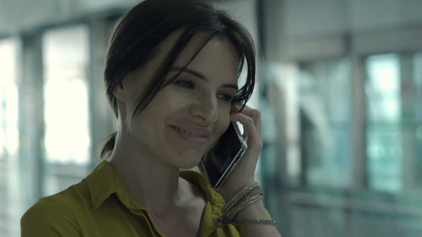 Young woman talking on cellphone at train station    Shutterstock HD Video #26676706