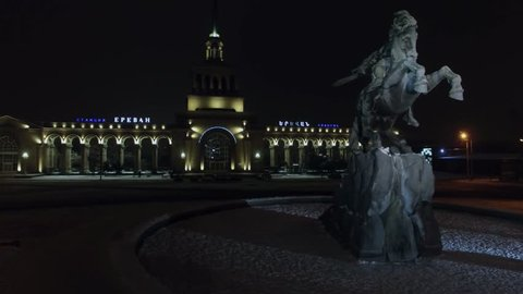 YEREVAN - JAN 05, 2017: Sasuntsi David monument near edifice of Yerevan railroad station at winter night. Aerial view
