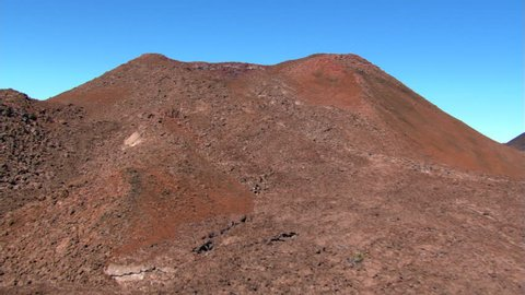 Flying over red cinder cone in Hawaii