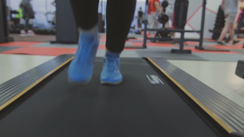 A woman trains on a treadmill in a fitness club #26702941
