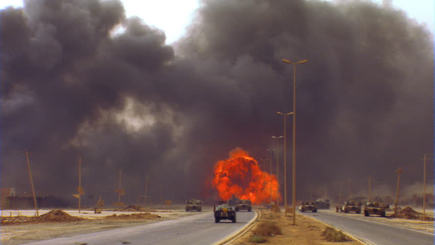 Military vehicles waiting while Iraqi roadway is cleared