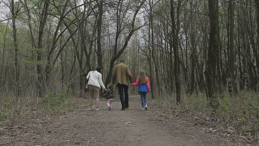 Family walks on the river bank in warm weather   Shutterstock HD Video #26746210