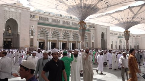 Medina, Saudi Arabia - September 5, 2016: Muslim believers stepping out from al-Masjid an-Nabawi, prophet Muhammad's Mosque, after the noon prayer, during hajj season.