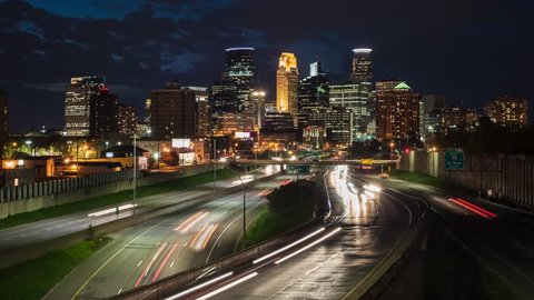 Time lapse video of traffic against the Minneapolis skyline during a busy evening. 4k time lapse, 4096x2304.